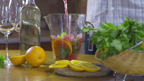 Making sangria slow motion stock video footage