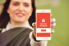 Making a secure payment with a mobile phone. Royalty Free Stock Photos