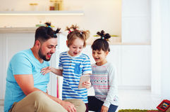 Making selfie snap shot with crazy hairstyle when you home alone with children. Making selfie snap shot with crazy hairstyle when you home alone with the stock photos