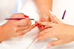 Making sharp artificial nails Stock Image