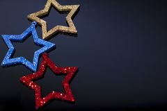 Making shiny decorative stars of different colors royalty free stock photo