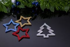 Making shiny decorative stars of different colors stock photography