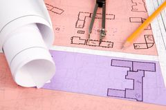 Making sketches. Close-up of blueprints with sketches of projects on workplace and some mechanical tools Stock Photos
