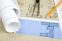 Making sketches. Close-up of blueprints with sketches of projects on workplace and some mechanical tools Stock Image
