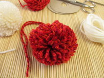 Making small pompons royalty free stock photo