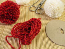 Making small pompons stock photography