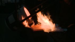 Making smelting of gold stock footage