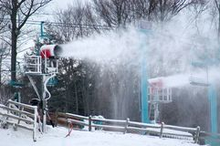 Making Snow. Snow machines in action on a ski slope getting ready for the season Royalty Free Stock Photo