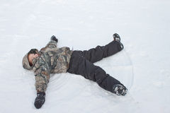 Making snow angels Stock Images