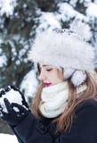 Making a snowball. Beautiful young woman enjoying making a snowball Stock Photo