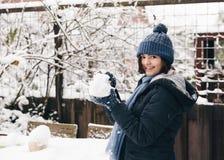 Making snowballs in a backyard stock image