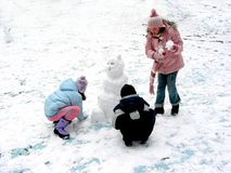 Making a snowman stock photography