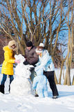 Making snowman Royalty Free Stock Image