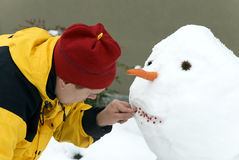 Making the snowman stock photography