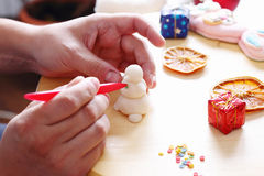 Making snowman from sugar mastic Royalty Free Stock Images