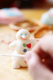 Making snowman from sugar mastic Royalty Free Stock Image