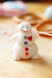 Making snowman from sugar mastic Stock Photography