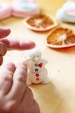 Making snowman from sugar mastic Royalty Free Stock Photos