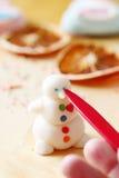 Making snowman from sugar mastic Stock Photos