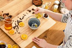 Making soap at home. On the countertop filled with honey, oranges and cinnamon royalty free stock images