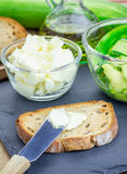 Making soft cheese and zucchini bruschetta Stock Photography