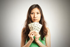 Making some money. Asian woman making some money royalty free stock images