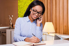 Making some urgent notes. Stock Photography