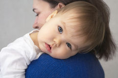 Making soothe a baby. Making soothe the child -baby laying head on mother's arm Stock Photos