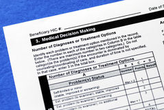 Making a sound medicine decision. By reviewing the diagnoses and treatment options Royalty Free Stock Image