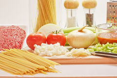 Making Spaghetti. Ingredients ready to cook spaghetti with tomato sauce Royalty Free Stock Images