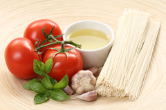 Making spaghetti. Ingredients to make delicious spaghetti - food and drink Royalty Free Stock Images