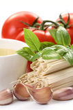 Making spaghetti. Ingredients to make delicious spaghetti - food and drink Stock Photos