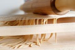 Making spaghetti alla chitarra with a tool. Specialty of Abruzzo region Stock Photos