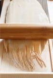 Making spaghetti alla chitarra with a tool. Specialty of Abruzzo region Stock Photography