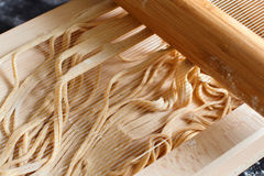 Making spaghetti alla chitarra with a tool. Specialty of Abruzzo region Stock Images