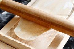 Making spaghetti alla chitarra with a tool. Specialty of Abruzzo region Royalty Free Stock Photo