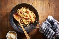 Making spaghetti a la carbonara Stock Photos