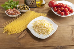 Making of spaghetti. Pasta and vegetables and cheese Royalty Free Stock Photo