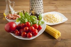 Making of spaghetti. Pasta and vegetables and cheese Royalty Free Stock Photography