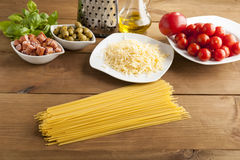 Making of spaghetti. Pasta and vegetables and cheese Royalty Free Stock Images