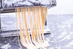 Making spaghetti. Using traditional pasta machine to make some spaghetti Stock Images