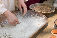 Making spelled (einkorn) bread. Making dough for spelled (einkorn) bread in a traditional way for the Neolithic era in today stock images