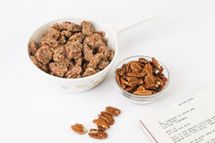 Making Spiced Pecans with Recipe Royalty Free Stock Photography