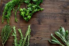 Making spices with fresh herbs and greenery for cooking wooden kitchen table background top view mockup Stock Photography