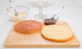 Making sponge cake, cake split ready to put filling in Stock Photography