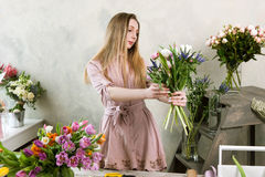 Making spring bunch in floristry flower shop. Royalty Free Stock Photo