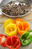 Making stuffed bell peppers stock photography