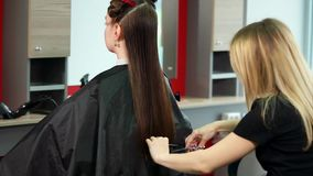 Making stylish hairstyle in fashionable beauty salon. Female customer stock footage