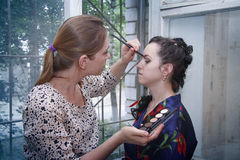 Making stylish  makeup and coiffure Royalty Free Stock Image
