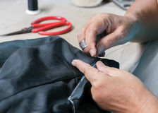 Making suits ,tailoring. By hand Royalty Free Stock Images